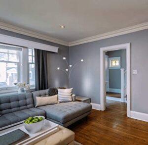 LED tree floor lamp beside sofas