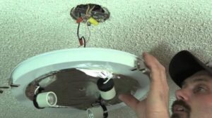 remove the old ceiling light fixture